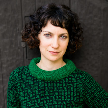 Simone Vitucci green sweater